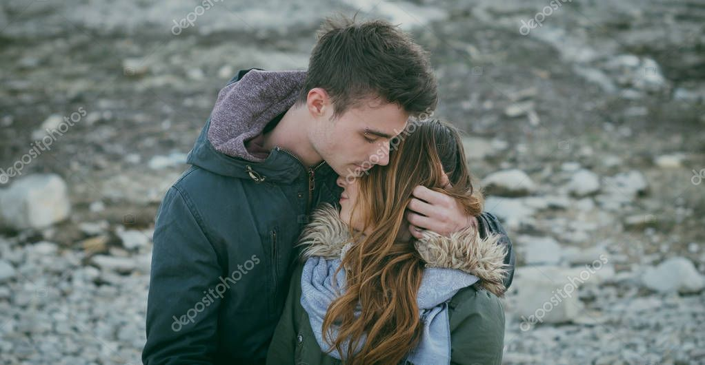 Romantic sweet teen couple hugging
