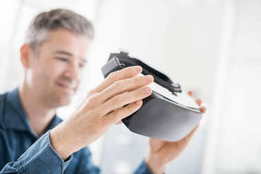 Man holding a VR viewer