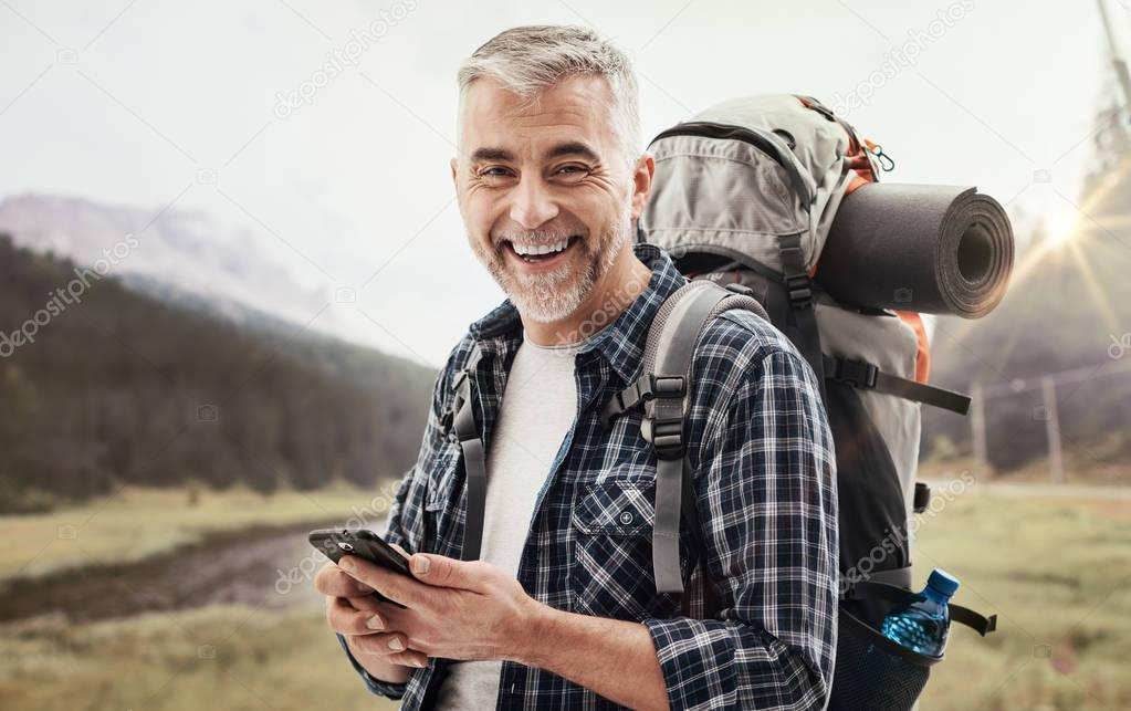Hiker using a smartphone