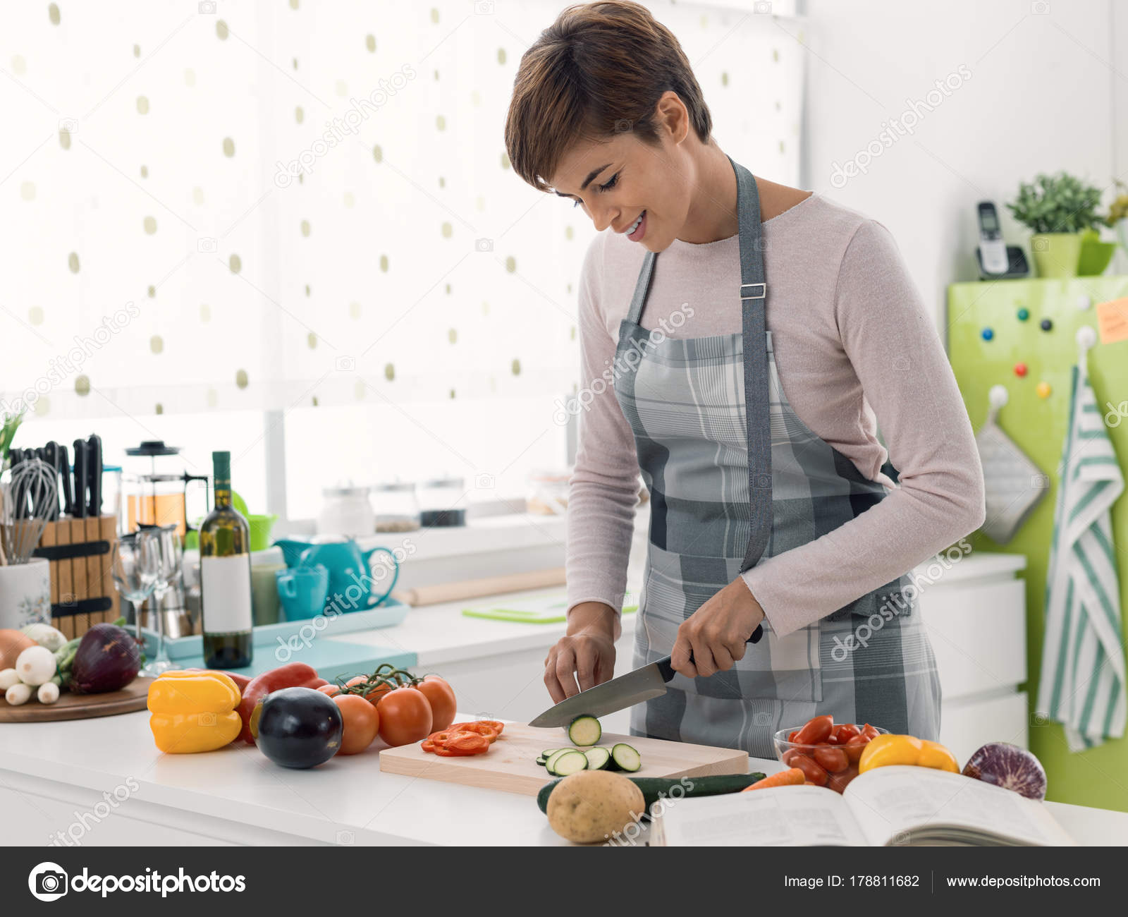 Young woman cooking in the kitchen — Stock Photo © stockasso #178811682