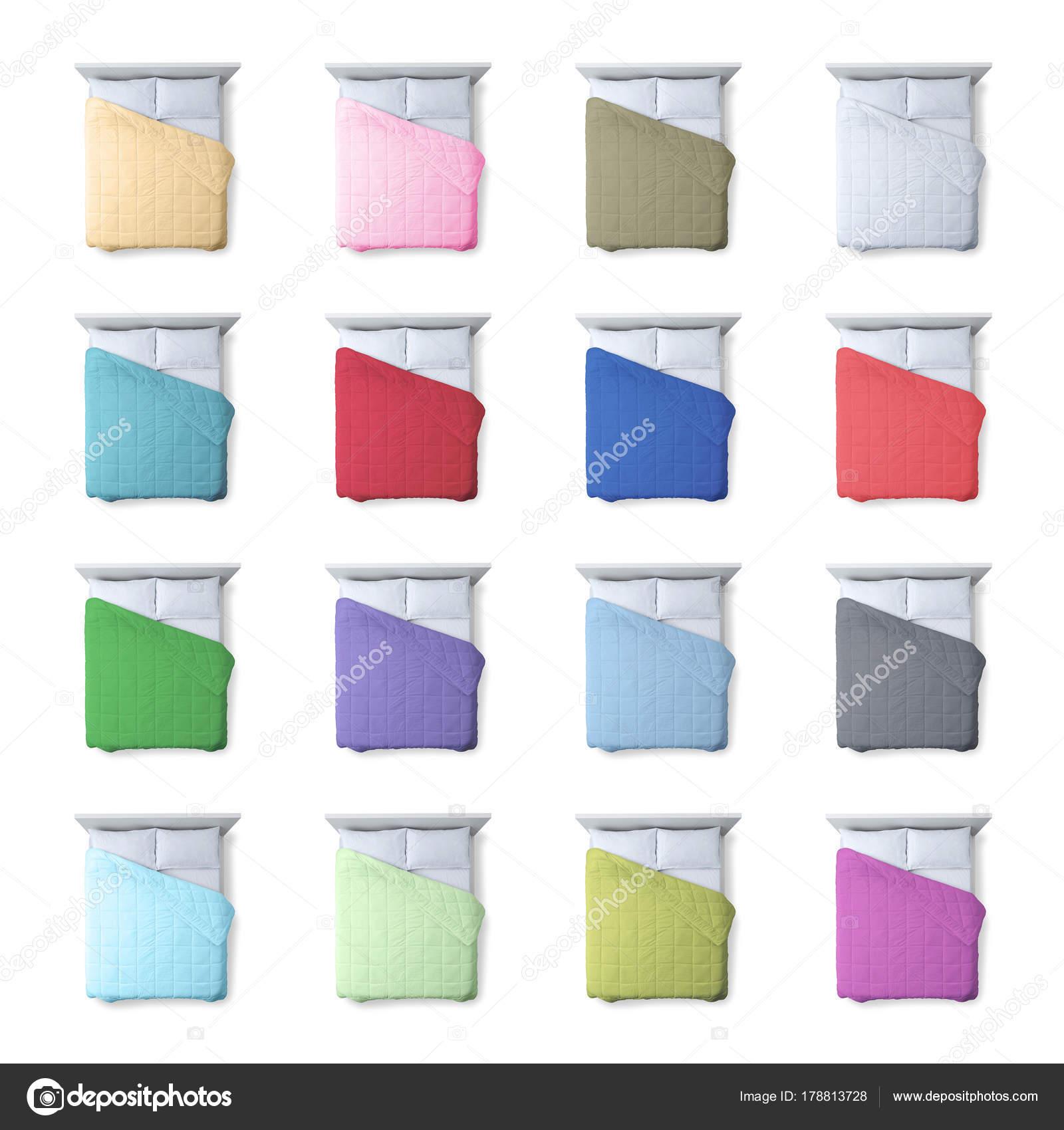 huge selection of 14f6b b7edc Collezione di piumini colorati sui letti — Foto Stock ...