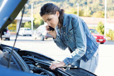 Woman calling car assistance