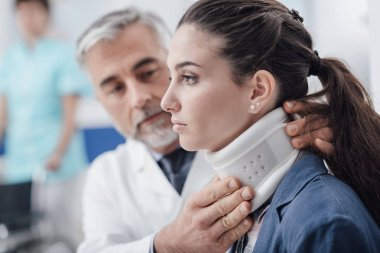 Doctor visiting a patient with cervical collar