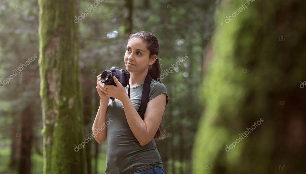 Photographer taking pictures in the forest