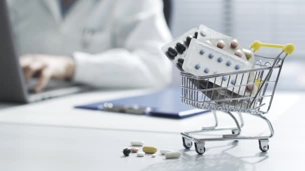 Shopping cart with pills on the doctors desktop