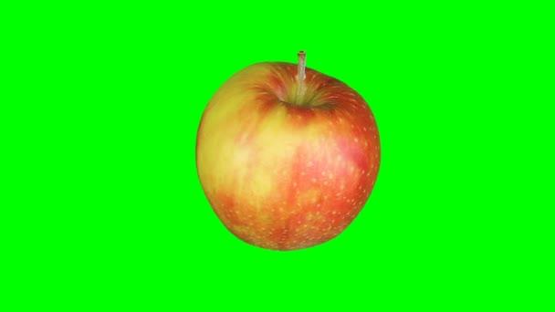 Čerstvé červené jablko izolované na zelené obrazovce