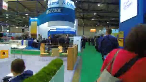 Stands with people and agro exhibits.