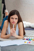 Woman drawing on adult coloring book