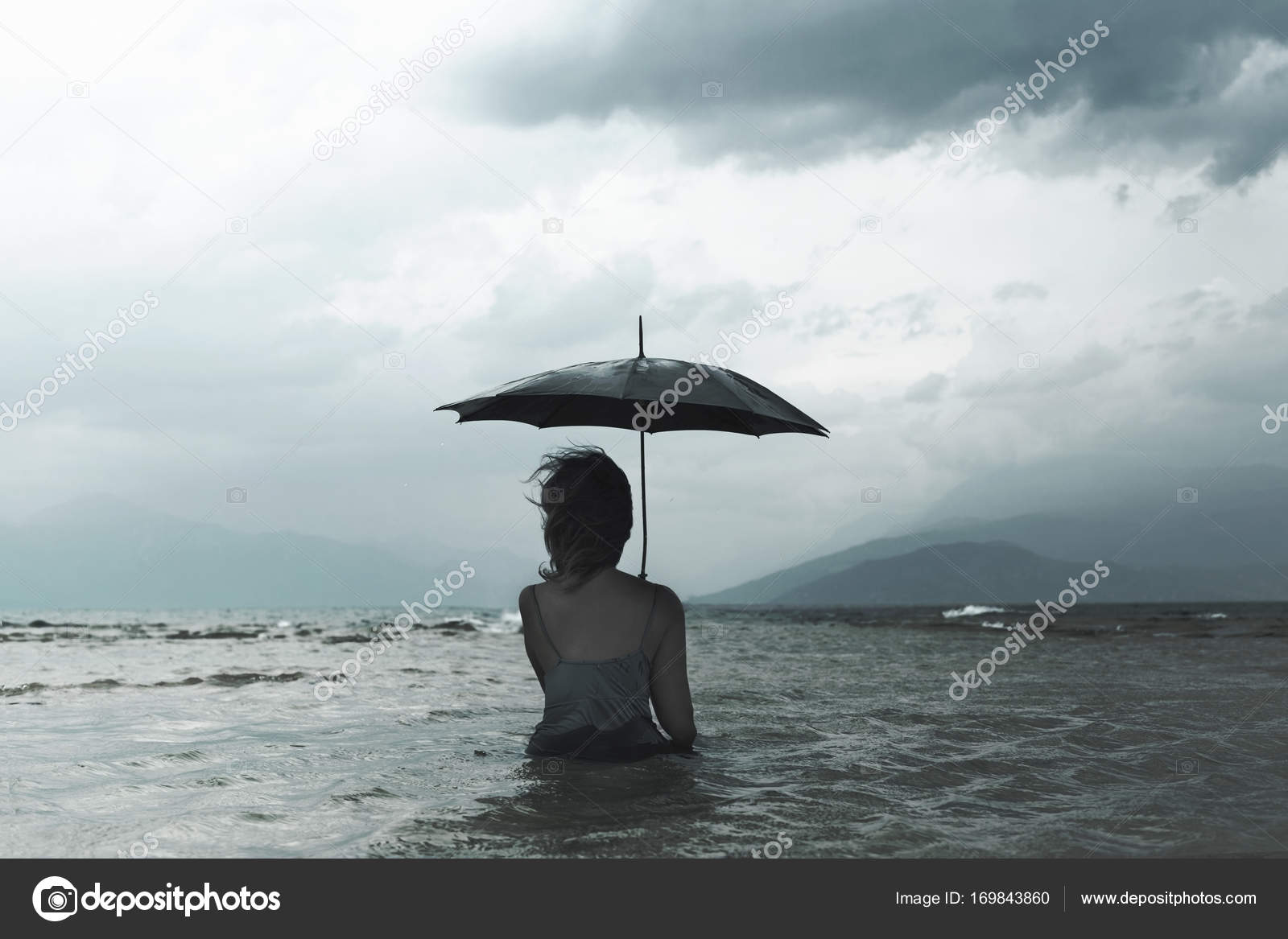 Dreaming Woman With Umbrella Waiting For The Storm Into The Sea