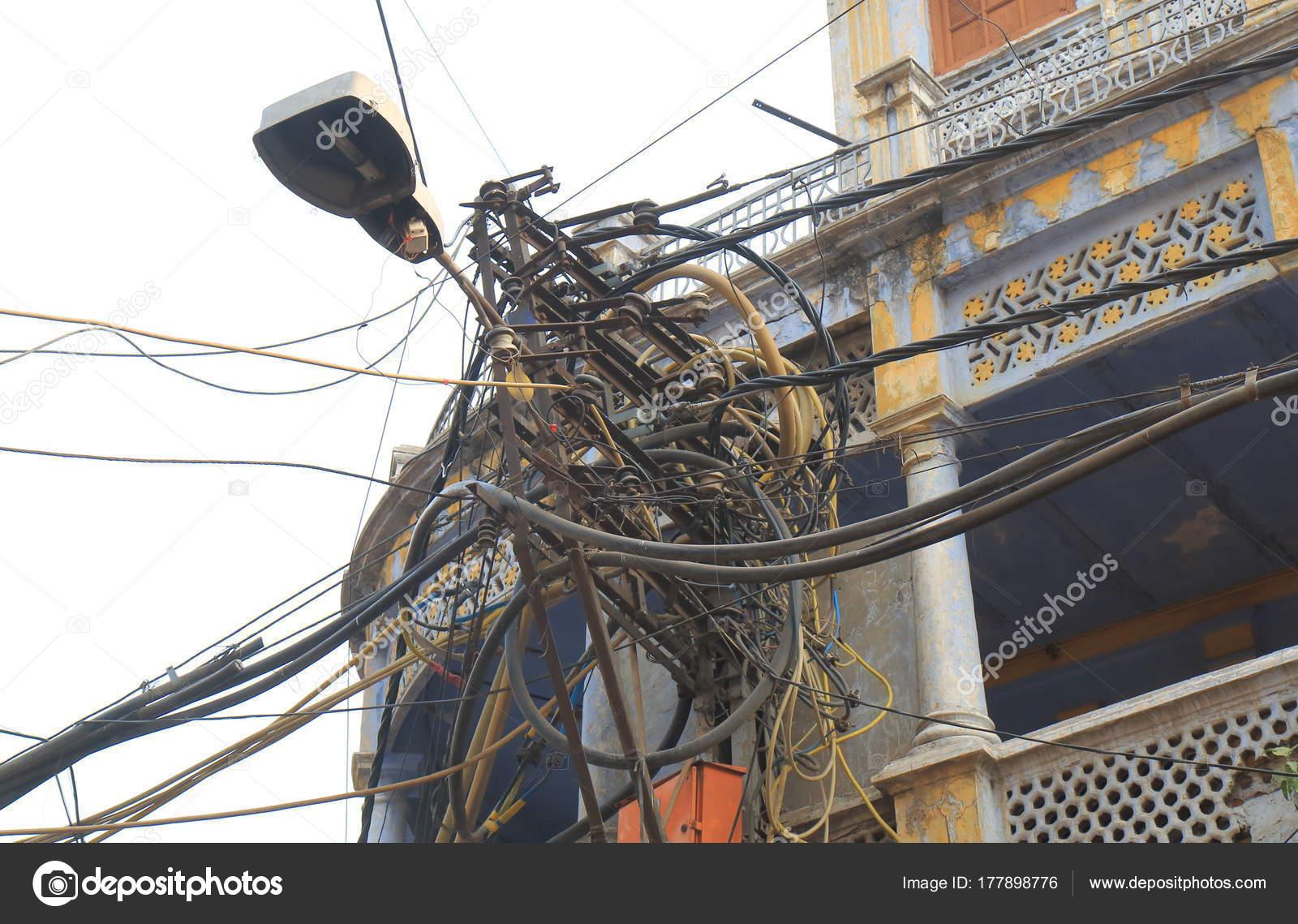 electric wire telephone pole delhi india stock photo tkkurikawa rh depositphotos com India Electrical Wiring Mess Telco Wiring India