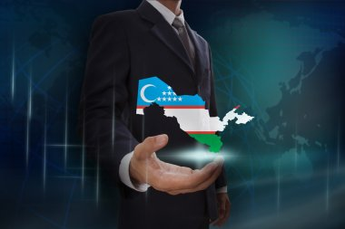 Businessman with map and flag of Uzbekistan