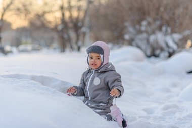 Cute child playing with snow