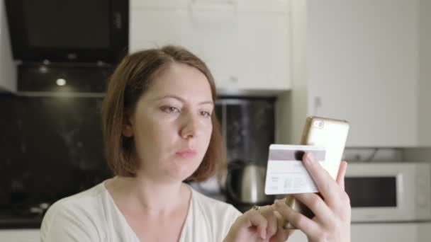 Girl enters credit card number on a smartphone