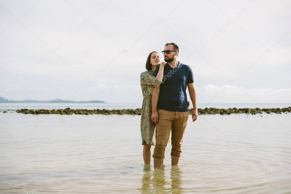 Young love couple on sea shore