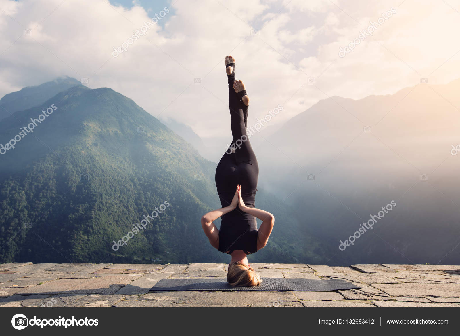 Young Woman Doing Complex Yoga Exercise Headstand With Namaste Asana Amazing Landscape In Beautiful Mountains Photo By AnnaTamila