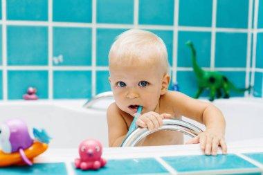 Funny little baby boy in bathroom