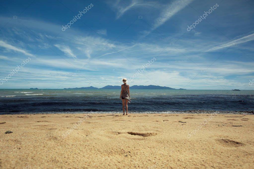 woman near black dirty water