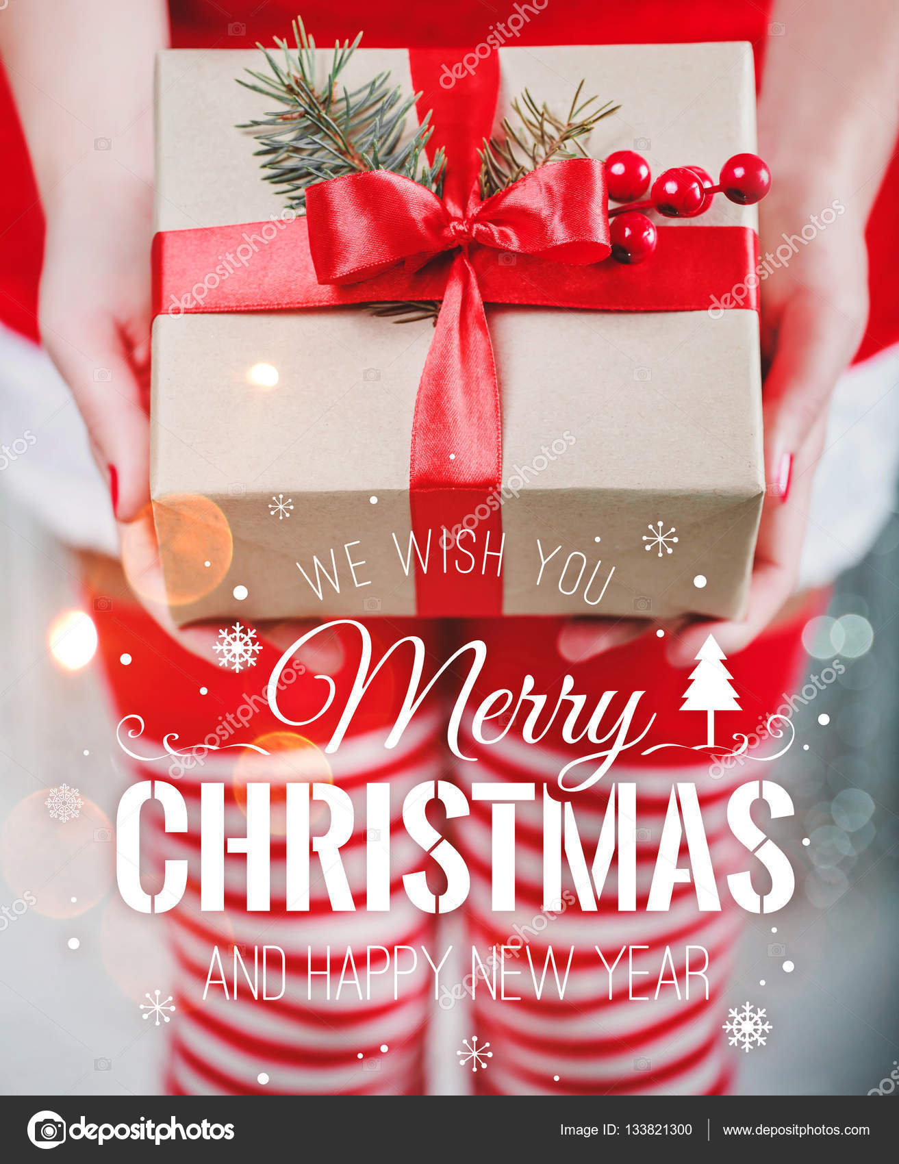 Female hands holding christmas gift box with red ribbon and merry female hands holding christmas gift box with red ribbon and merry christmas and new year typographical negle Choice Image