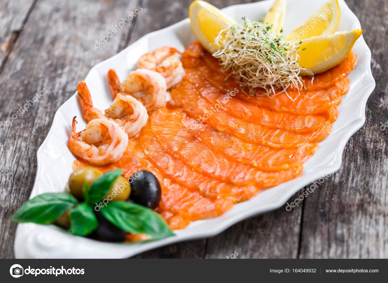 Seafood Platter With Salmon Slice And Shrimp Decorated With Olives And Lemon On Wooden Background Close Up Mediterranean Appetizers Top View Stock Photo C Valentinjukov 164049932