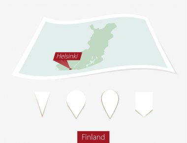 Curved paper map of Finland with capital Helsinki on Gray Background.