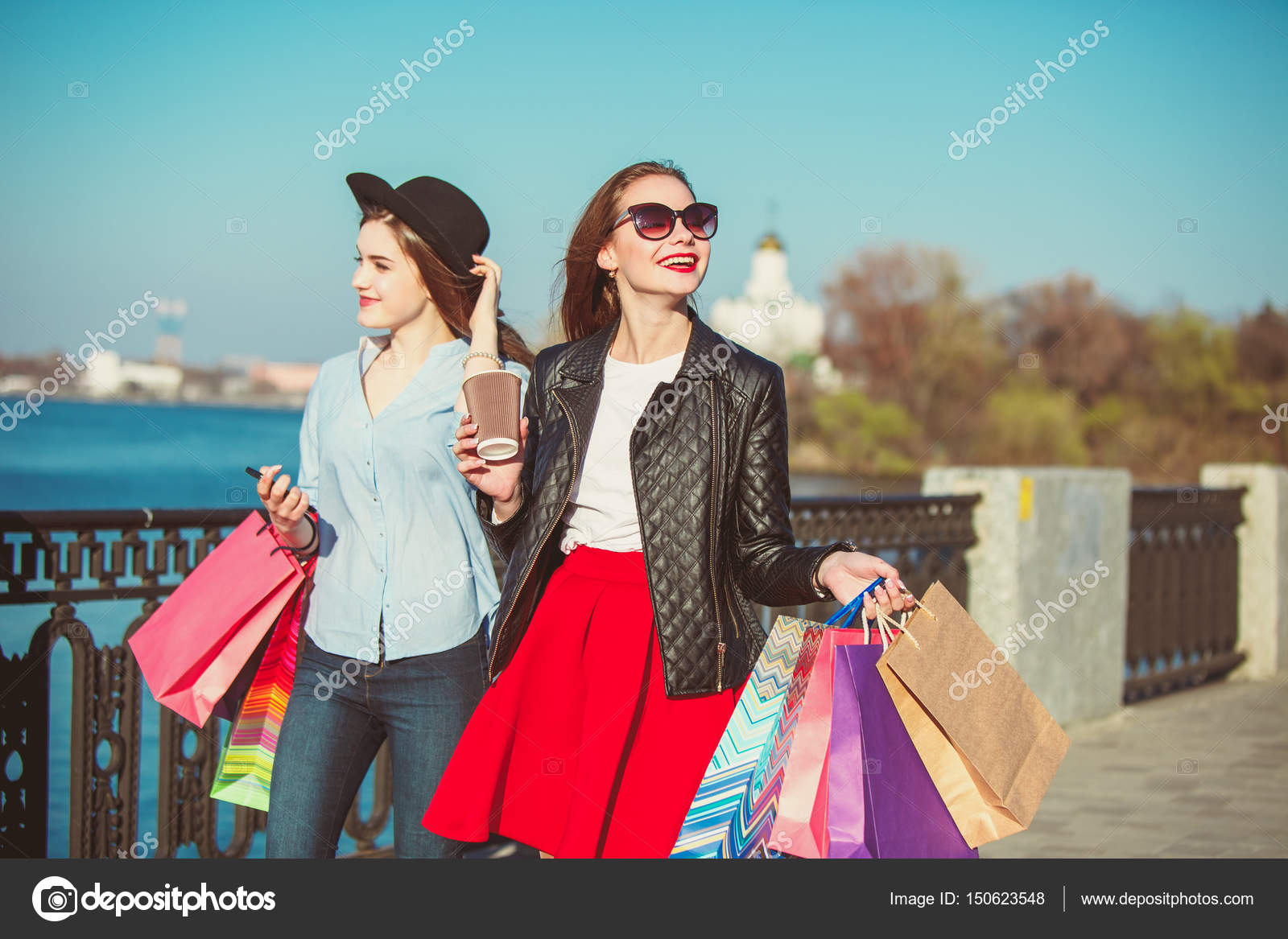Two Girls Walking With Shopping On City Streets Stock Photo