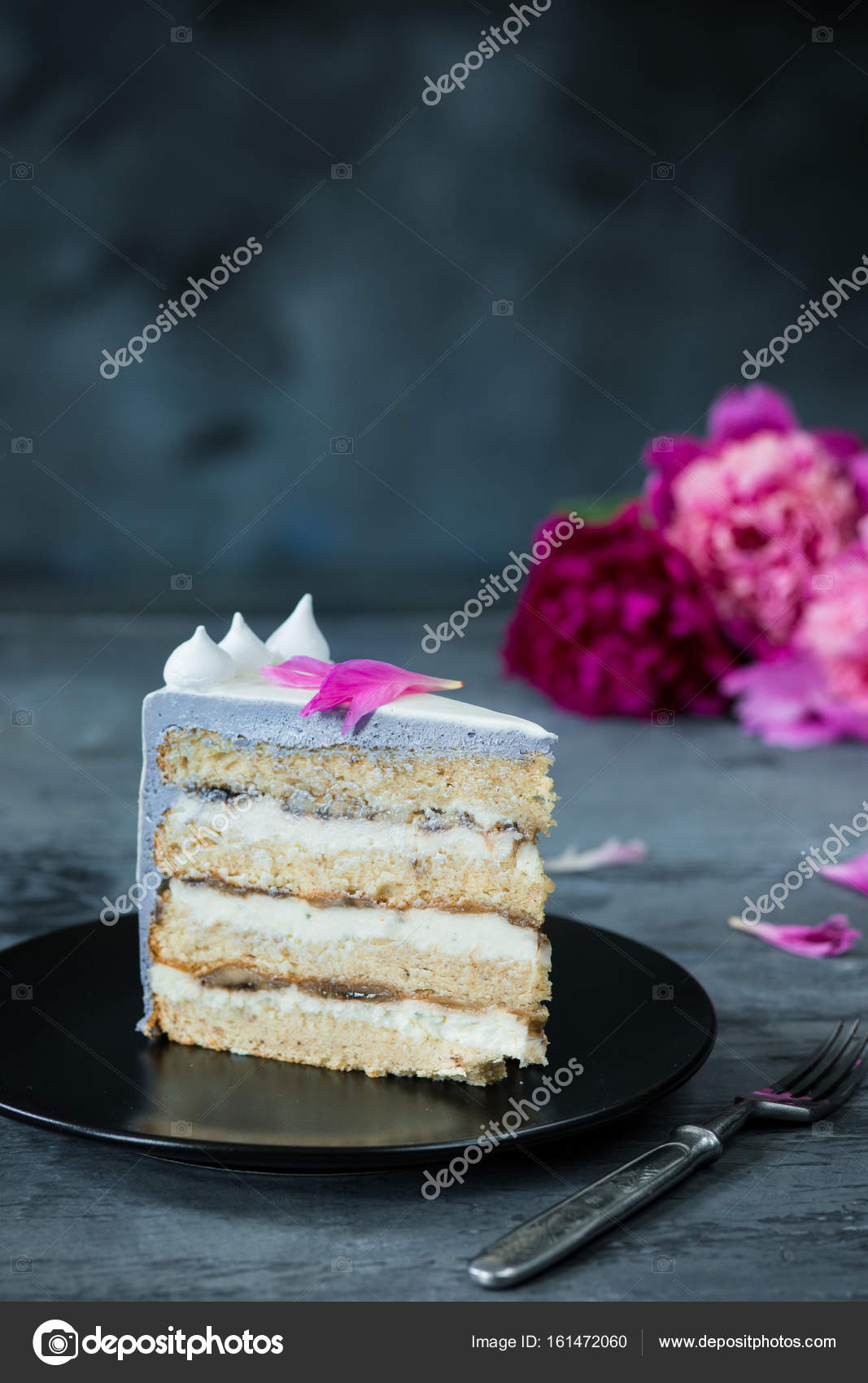 Slice of birthday cake with a flowers over a blue background slice of birthday cake with a flowers on a blue background photo by vova130555gmail izmirmasajfo