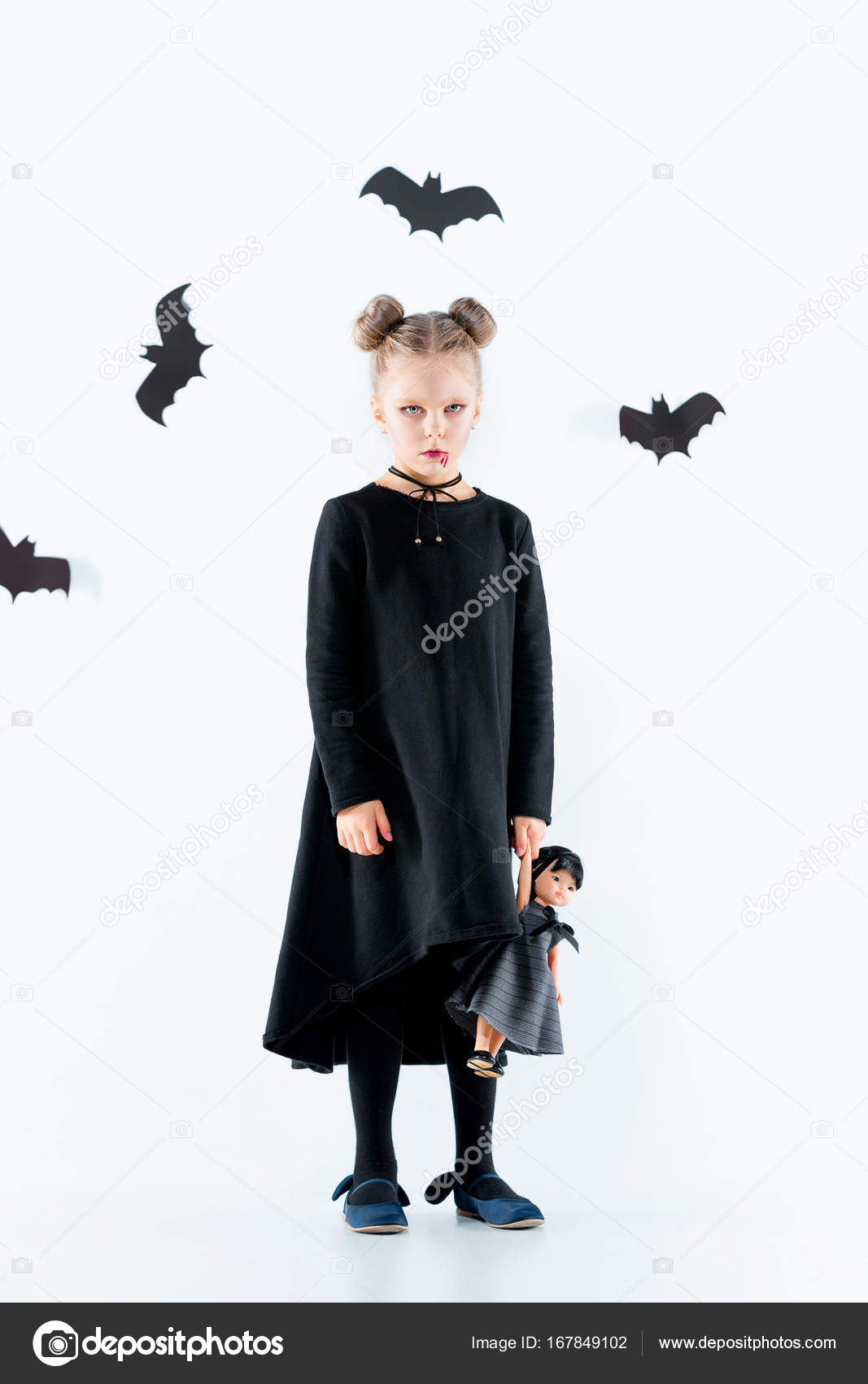 Little girl witch in black dress over magical accessories. Halloween the studio evening.  sc 1 st  Depositphotos & Little girl witch in black dress over magical accessories. Halloween ...