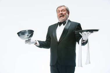 The waiter with tray and metal cloche lid cover