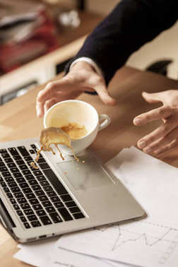 Coffee in white cup spilling on the table in the morning working day at office table