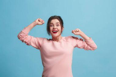 Winning success woman happy ecstatic celebrating being a winner. Dynamic energetic image of female model