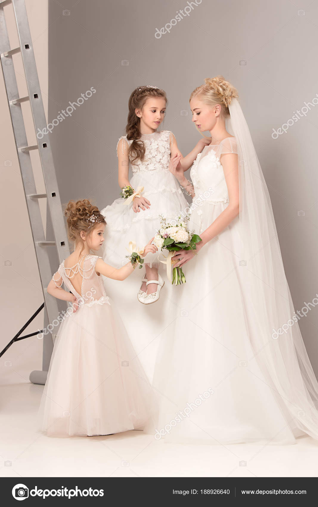 Little pretty girls with flowers dressed in wedding dresses — Stock ...