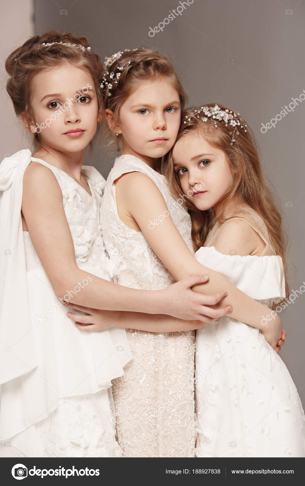 Little Pretty Girls With Flowers Dressed In Wedding Dresses Stock