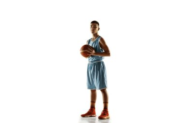 Full length portrait of a young basketball player with ball