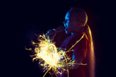 Caucasian girls portrait isolated on dark studio background in neon light