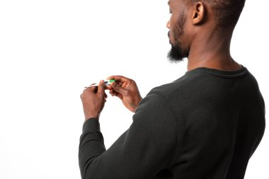 How coronavirus changed our lives. Young man checking, taking temperature on white background