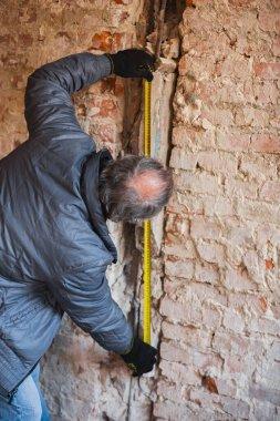 Repairman, professional builder working indoors, repairing