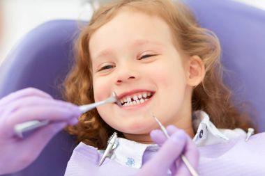 Smiling girl at dentist