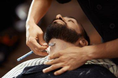 Crop man grooming client