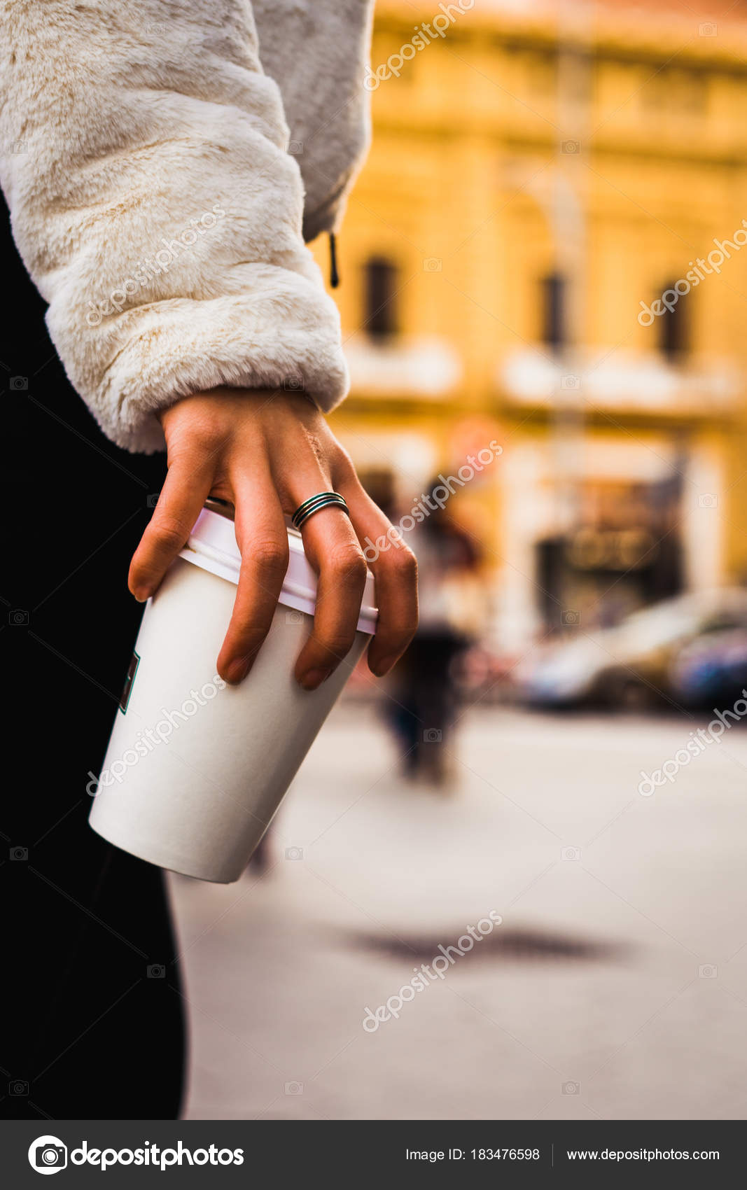 Crop stylish girl holding paper cup — Stock Photo © skat_36 #183476598