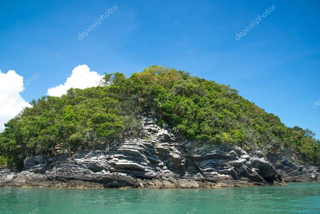simple island with pancake rock and transparent sea