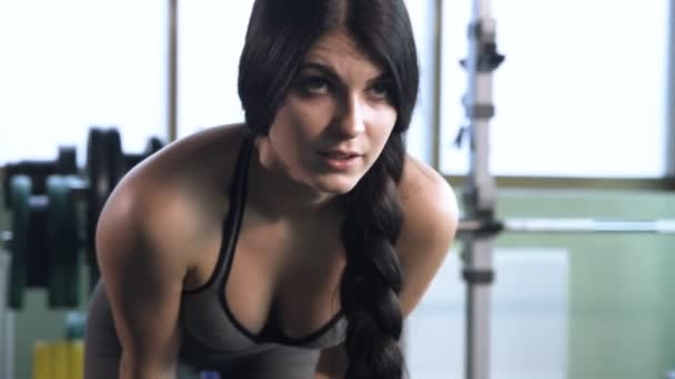 Young beautiful girl in a gym doing exercises.