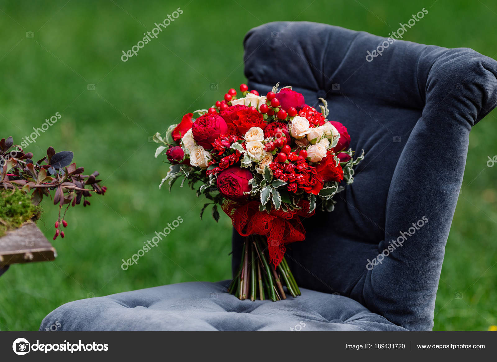 Expensive, trendy wedding bouquet of roses in marsala and red colors ...