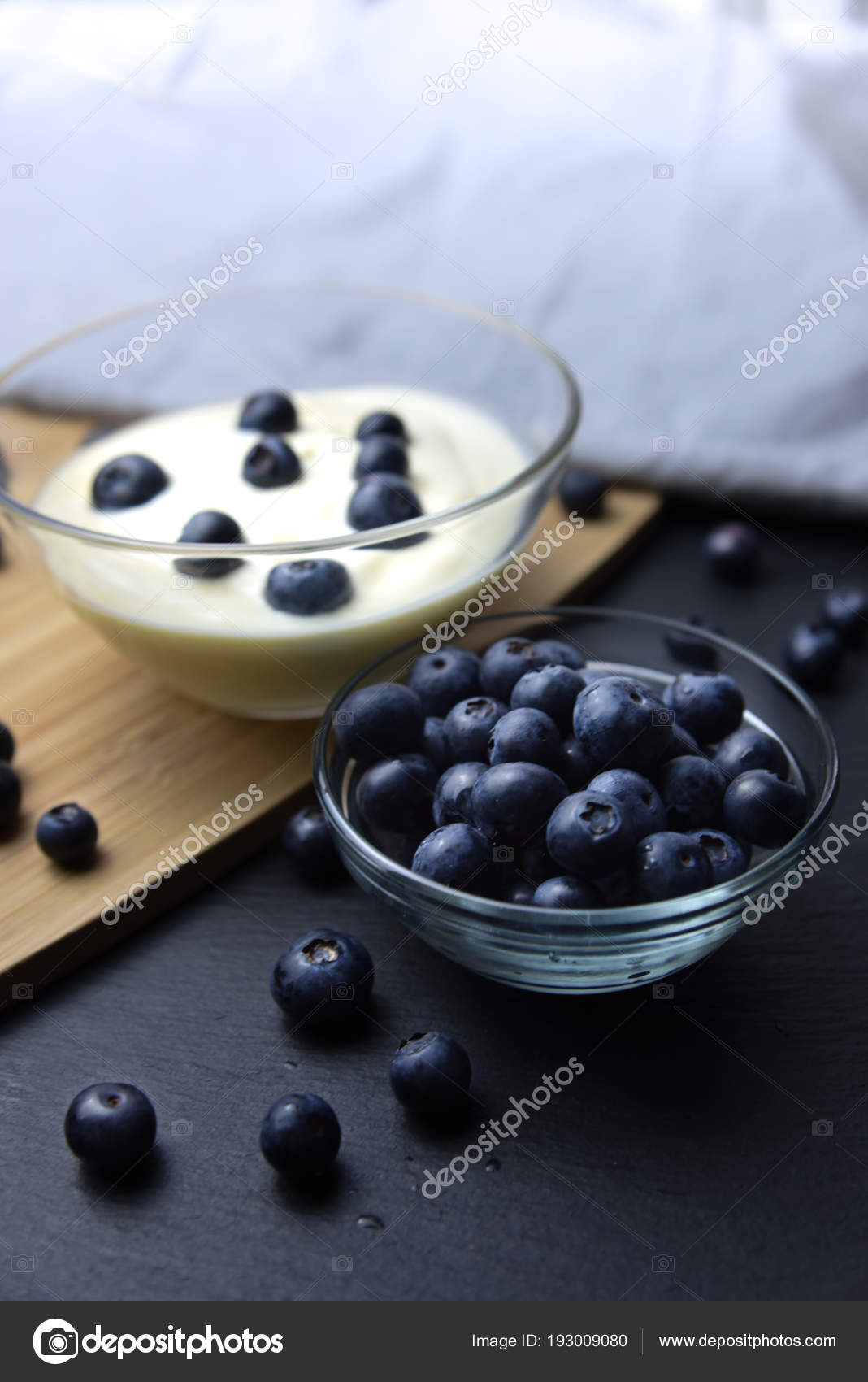 Blueberry Yogurt In Glass Bowl On Wooden Table Stock Photo