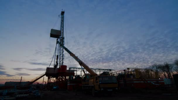 Timelapse Drilling Rig Oil Industry during Sunset