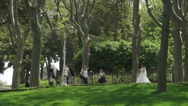 ISTANBUL, TURKEY, JUNE 3 2017: Groom takes pictures of the bride in Park