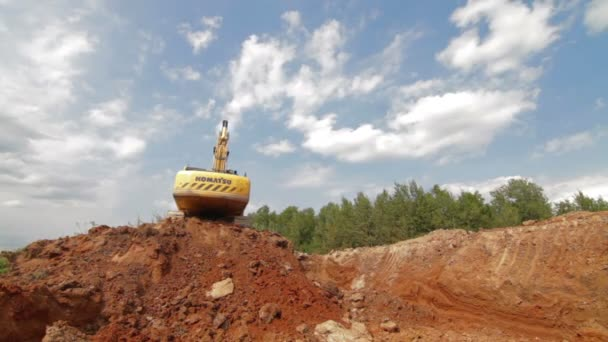 Russia, Moscow - 2016: Excavator Scooping and Dumping on Dirt Pile