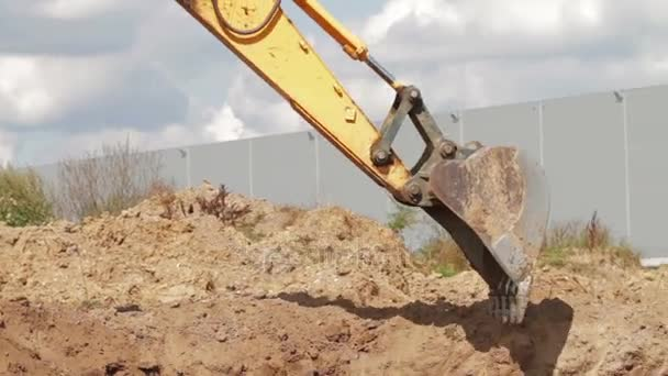 Bulldozer charging shovel with sand and transporting to pile