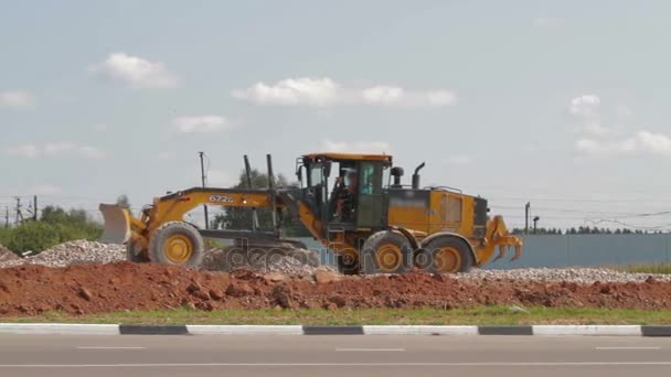 Loader excavator at road construction work
