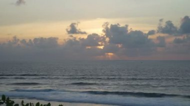 Timelapse Beautiful sunset at beach, light beam shining through cloudscape Bali