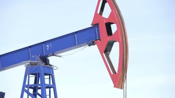 Oil Pump jack over a blue sky